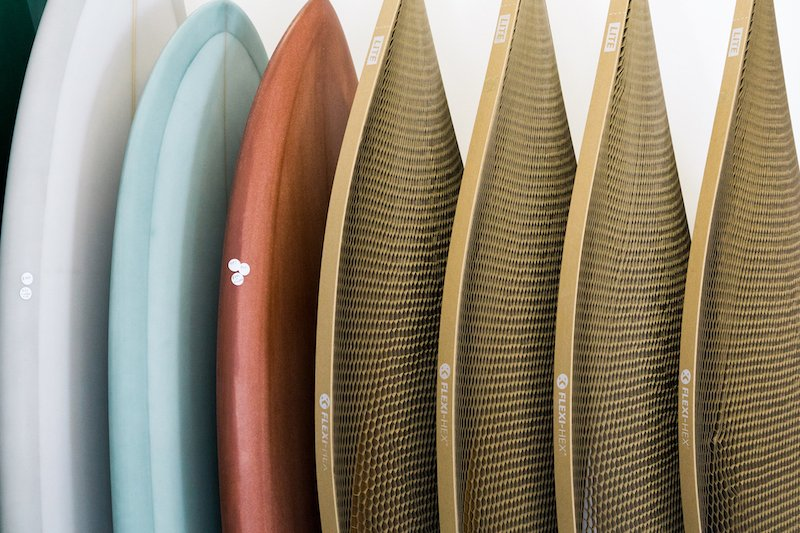 A row of surfboards in a rack wrapped in Flexi-Hex
