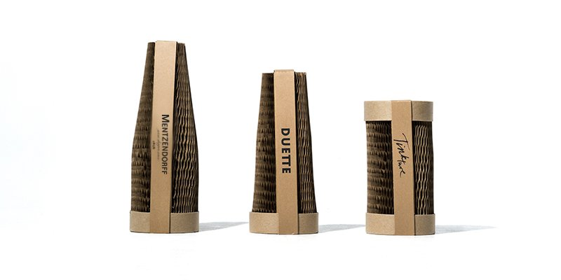 Wine and spirit bottles packaged in recyclable, plastic free packaging