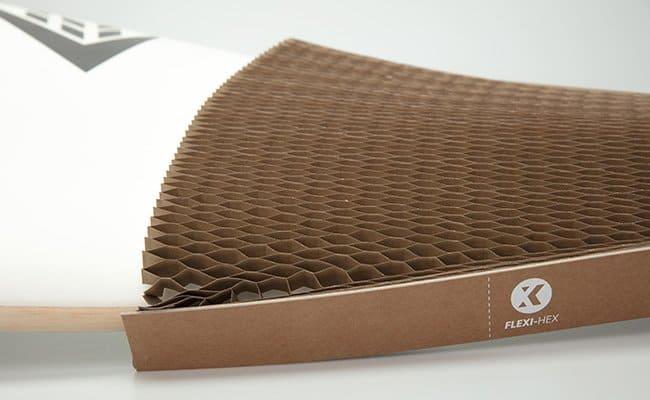 the honeycomb design of Flexi-Hex protecting a surfboard