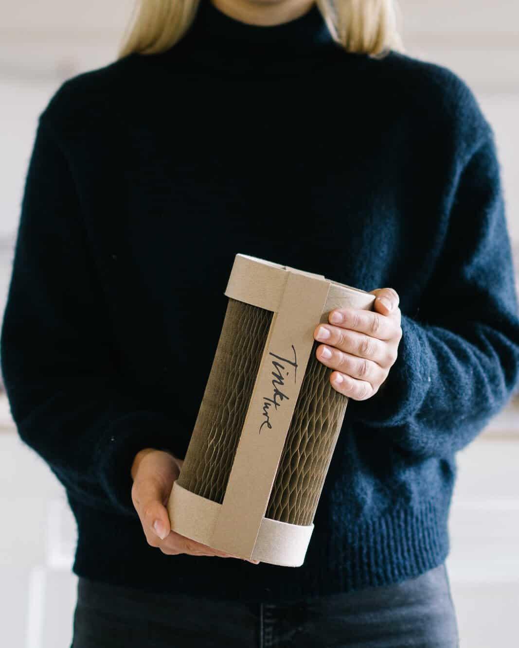 The Drum drinks packaging held in hands
