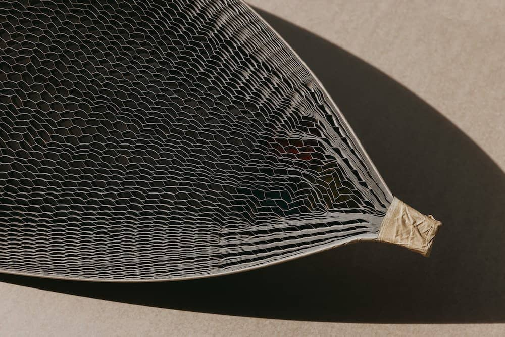 The nose of a surfboard wrapped in Flexi-Hex